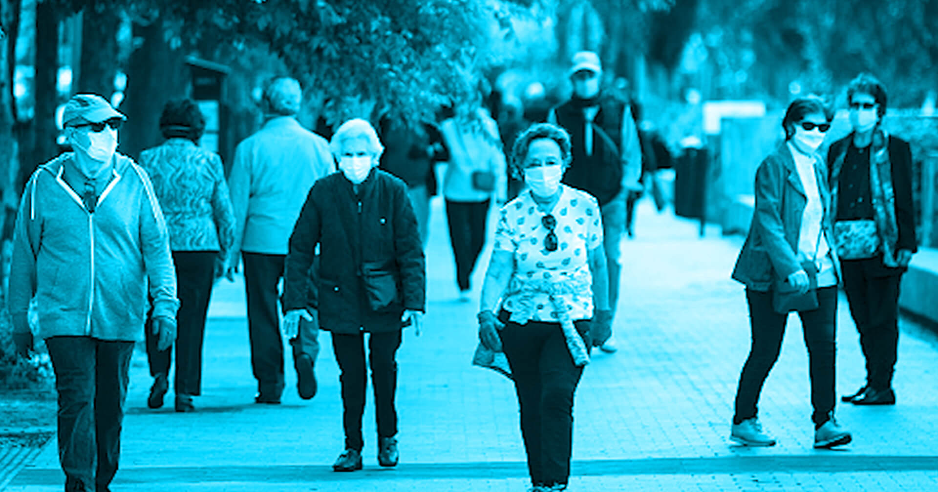 Elderly people walking outside with masks